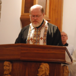 Fr. Stephen Wojcichowsky, MASI director, leads prayer at Black Ribbon Day service in Ottawa