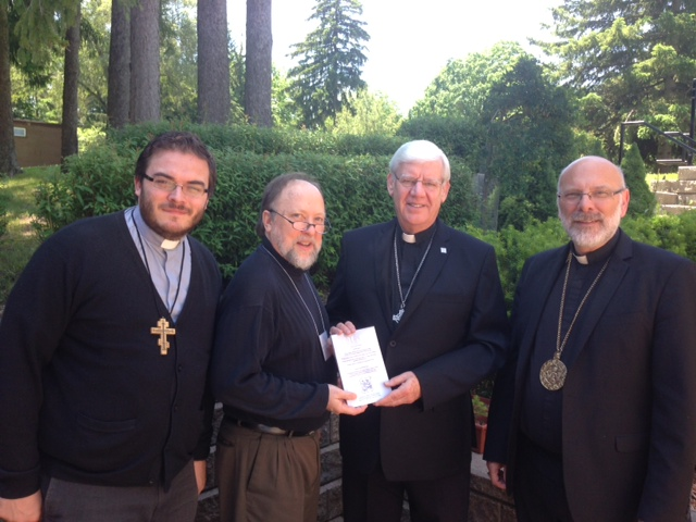 Fr Alexander, Fr Peter, His Excellency Bishop Ken, and Archbishop Daniel J Bohan, Archbishop of Regina and Chair of the CCCB Episcopal Commission