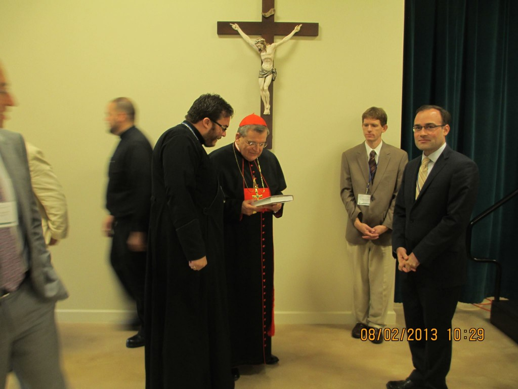 Fr Alexander presenting His Eminence with a copy of Eastern Christians in the New World