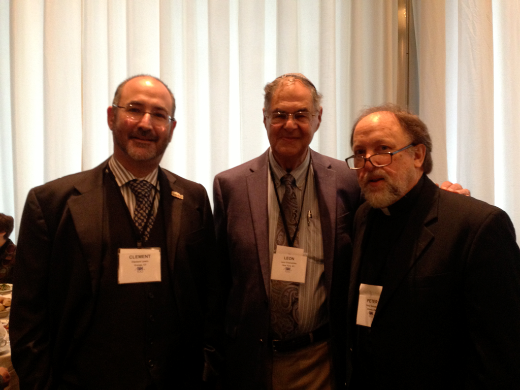Fr. Peter poses with Clement Lewin, son of Kurt Lewin, who was saved by Sheptytsky; and Dr. Leon Chameides, who was also saved by Sheptytsky. Clement Lewin was named in honour of Clement Sheptytsky, the brother of Metropolitan Andrey.