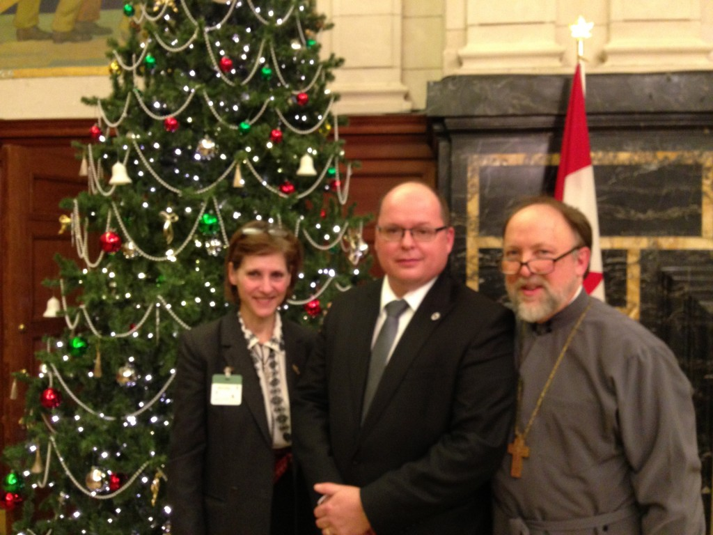Fr Peter Galadza with his wife Olenka and Taras Zaluski, executive director of the Ottawa office of the Ukrainian Canadian Congress