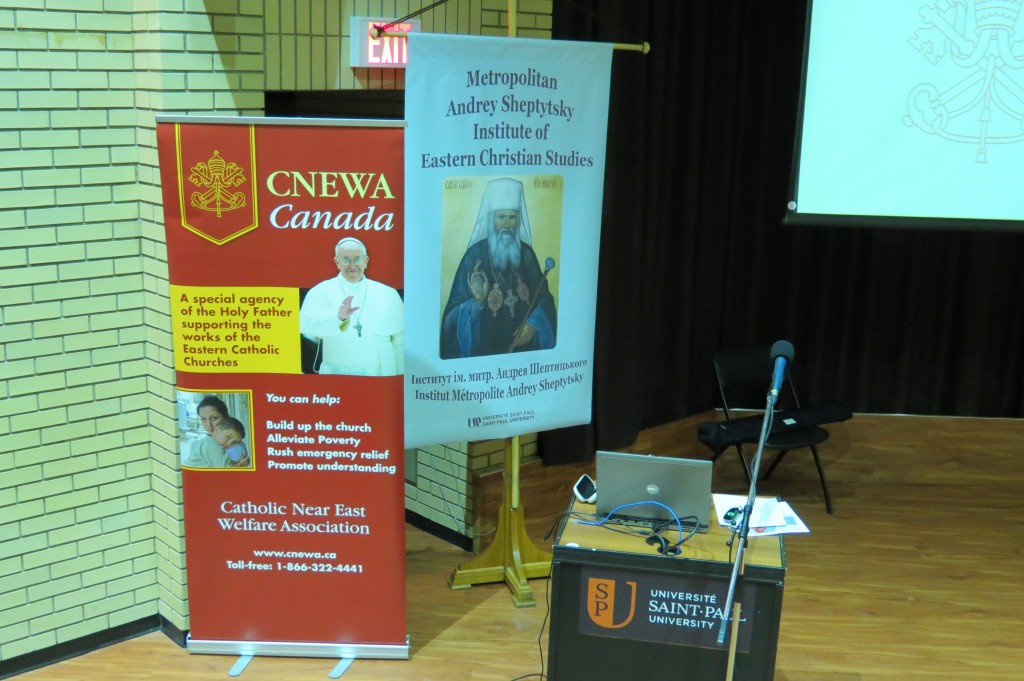 Banners at MASI's February Lecture. CNEWA is a papal charity.